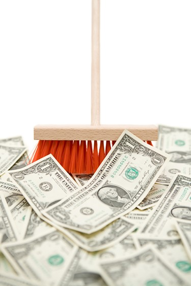 broom pushing money