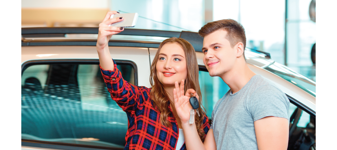 people taking selfie with car